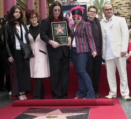 Ozzy Osbourne, center, poses with his family after he was honored with a star on the Hollywood Walk of Fame Friday, April 12, 2002. At far left is Osbourne's older daughter Aimee, his wife, Sharon, second left, Kelly, 17, third from right, and Jack, 16, second right, and his son Louis, from a previous marriage, is at far right. Photo by Nick Ut